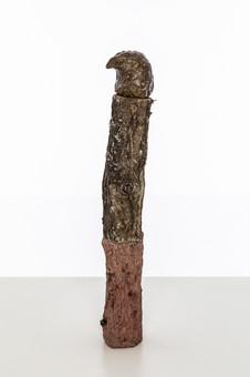 Totem II (Eagle ), 2019  Unfired clay, wax polish, oak tree branch, cement, pigment, lichen  47cm x 9cm x 8cm