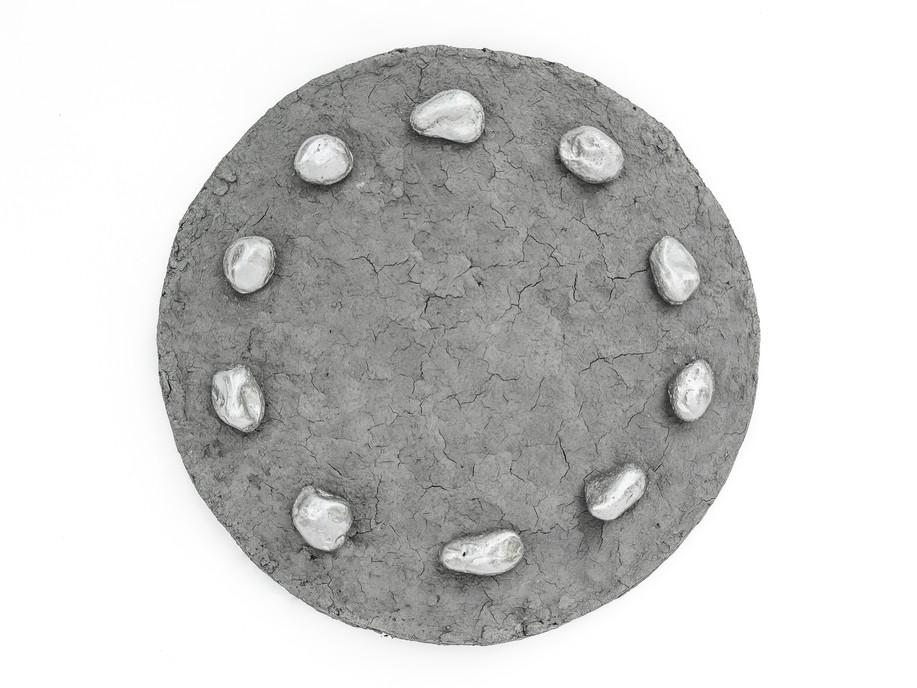 Lazarus Stones, 2018 Cast tin, clay dug from Black Ven cliffs 6cm x 35cm