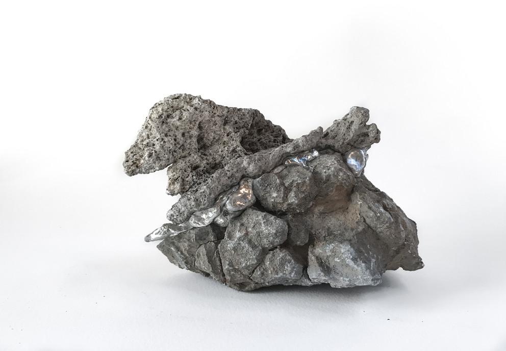 Crux, 2017  Reef rock, building rubble rock, tin 10cm  x 16cm x 12cm
