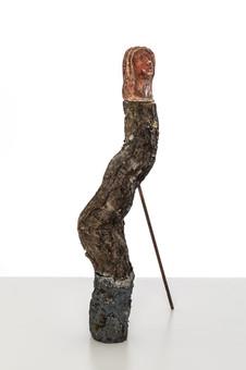 Totem I  (Medusa ), 2019  Tree branch, cement, black pigment, plaster, paint , rusted steel rod 55cm x 8cm x 10cm (excluding rod)
