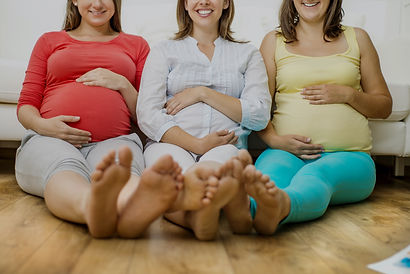 Three%20pregnant%20women%20sitting%20in%