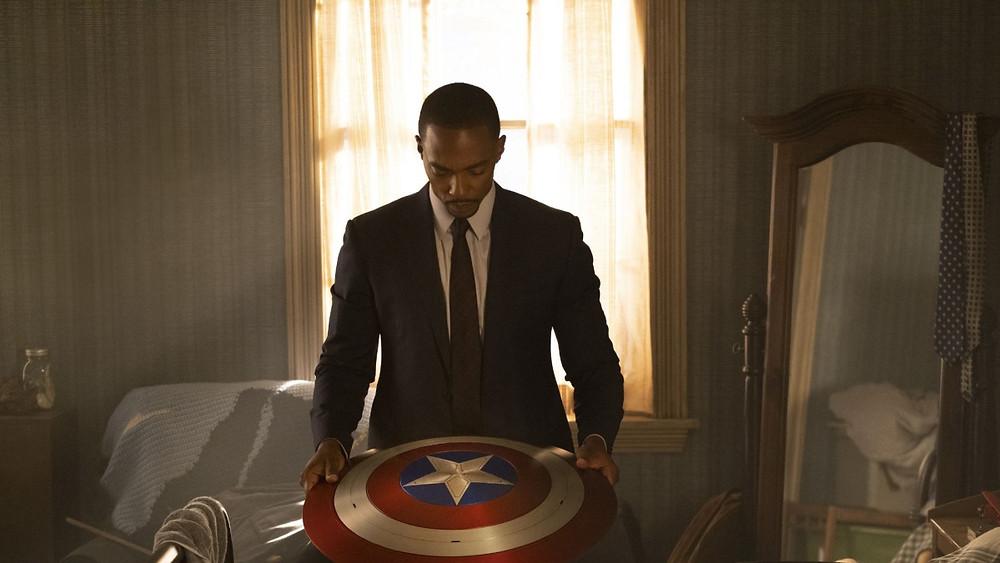 Sam Wilson (Anthony Mackie) contemplates the shield. (c) Disney+