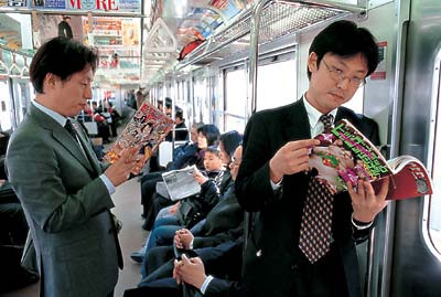 Reading manga on the commute in Japan
