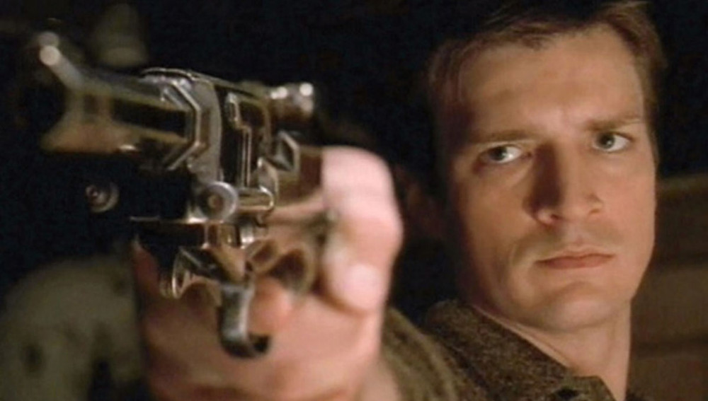 Captain Malcom Reynolds (Nathan Fillion) pointing a handgun at your face. Don't worry, he probably won't shoot...