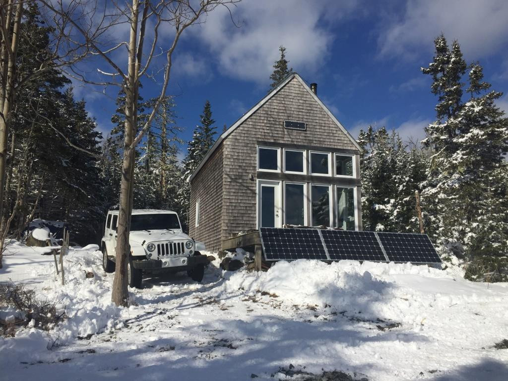off grid house in the snow