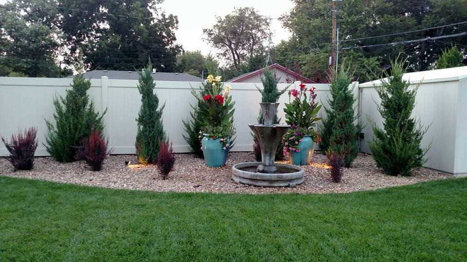 Shrub bed landscaping with pots and lighting Kellys Garden Sense