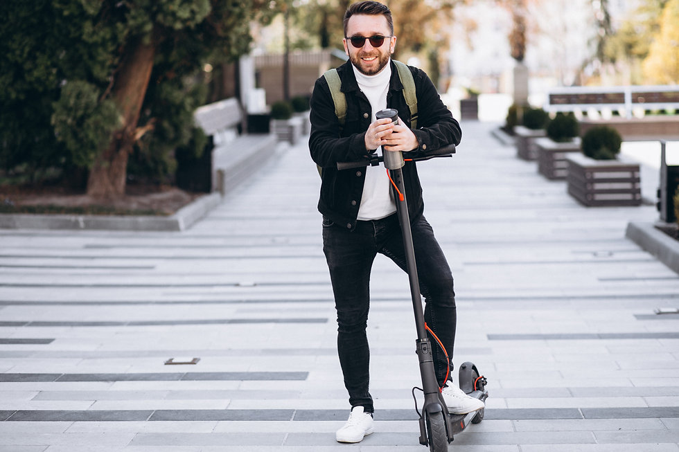 handsome-man-riding-scooter-drinking-cof