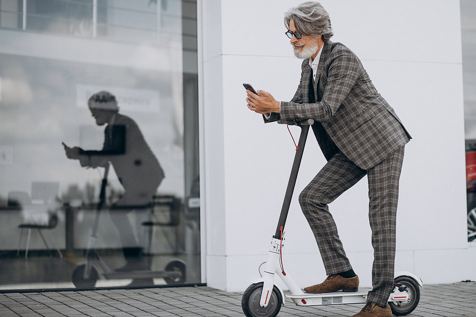 middle-aged-business-man-riding-scooter-
