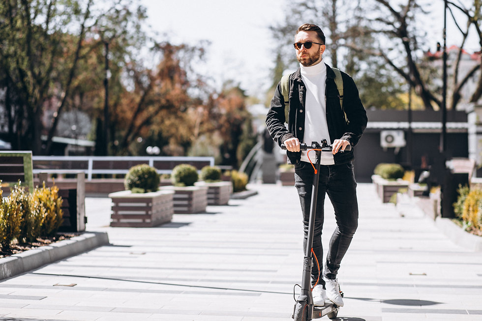 young-handsome-man-riding-scooter-park (