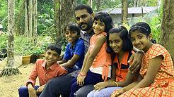 Edwin Livingston with kids.jpg