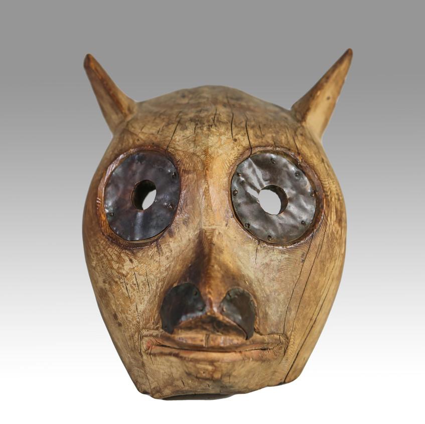 """Northwest Coast mask, British Columbia, c 1880, depicting a wolf or bear, 9"""" long"""