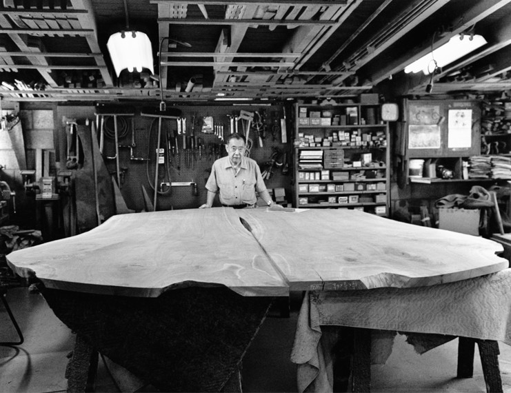 George Nakashima in his studio with a large table