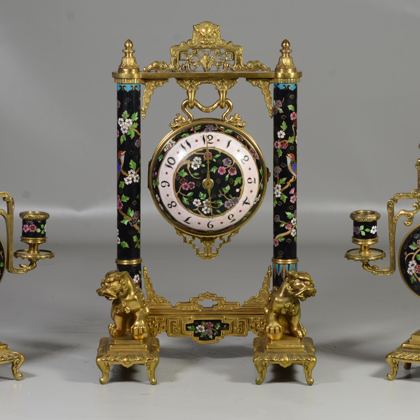 """3 pc French bronze and cloisonne Japy Freres Chinese style clock set, the ball encased movement hanging as a gong from a frame with bronze Chinese elements and cloisonne columns, with foodog supports, the clock 15-1/2"""" tall, with a pair of matching candlesticks, 12-1/4"""" h"""