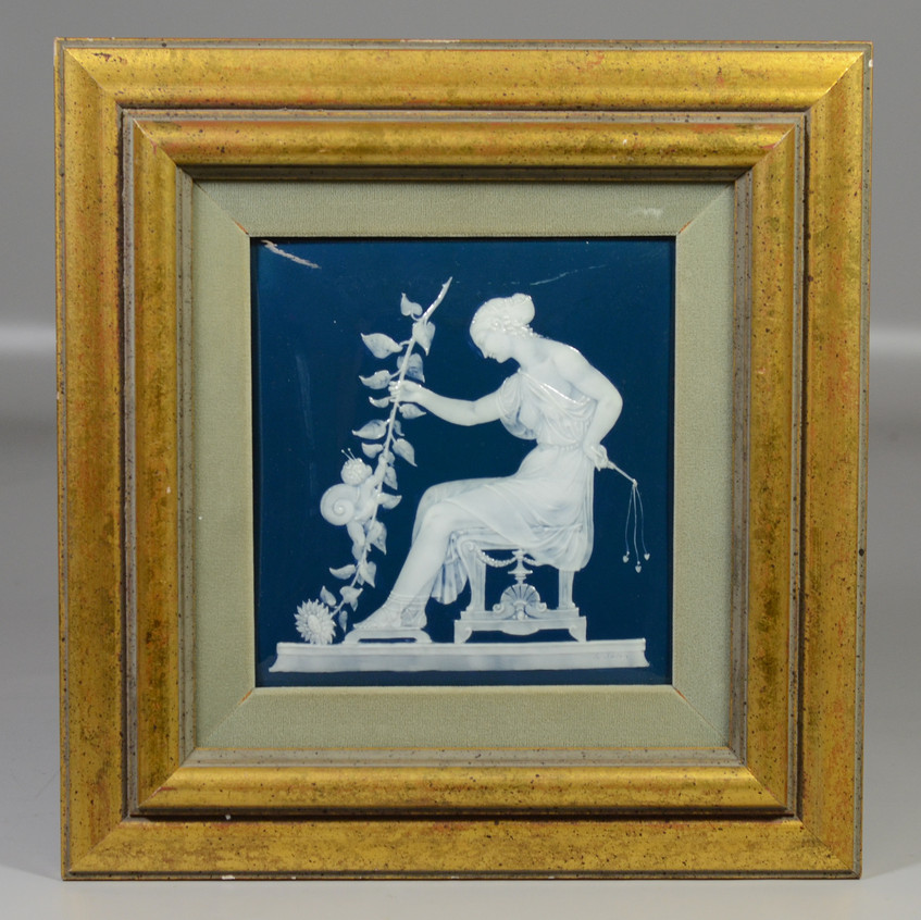 """Mintons pate sur pate tile, white on peacock blue, by Louis Solon, depicting a seated woman with cherub crawling up a floral stem, with stamped MINTONS mark, 7 3/4"""" x 7"""""""