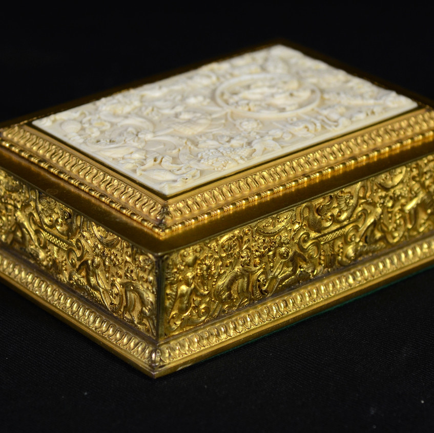 """EF Caldwell & Co gilt bronze humidor with carved ivory panel in lid depicting a mythological scene, the bronze body decorated on all sides with mythological scenes, dehumidifying panel inside, signed """"EF Caldwell & Co, New York"""" inside lid, c 1895-1910, 6-7/8"""" x 5-1/8"""", 2"""" high, lined in mahogany. Cannot be shipped to CA, NY, NJ, or out of the US."""