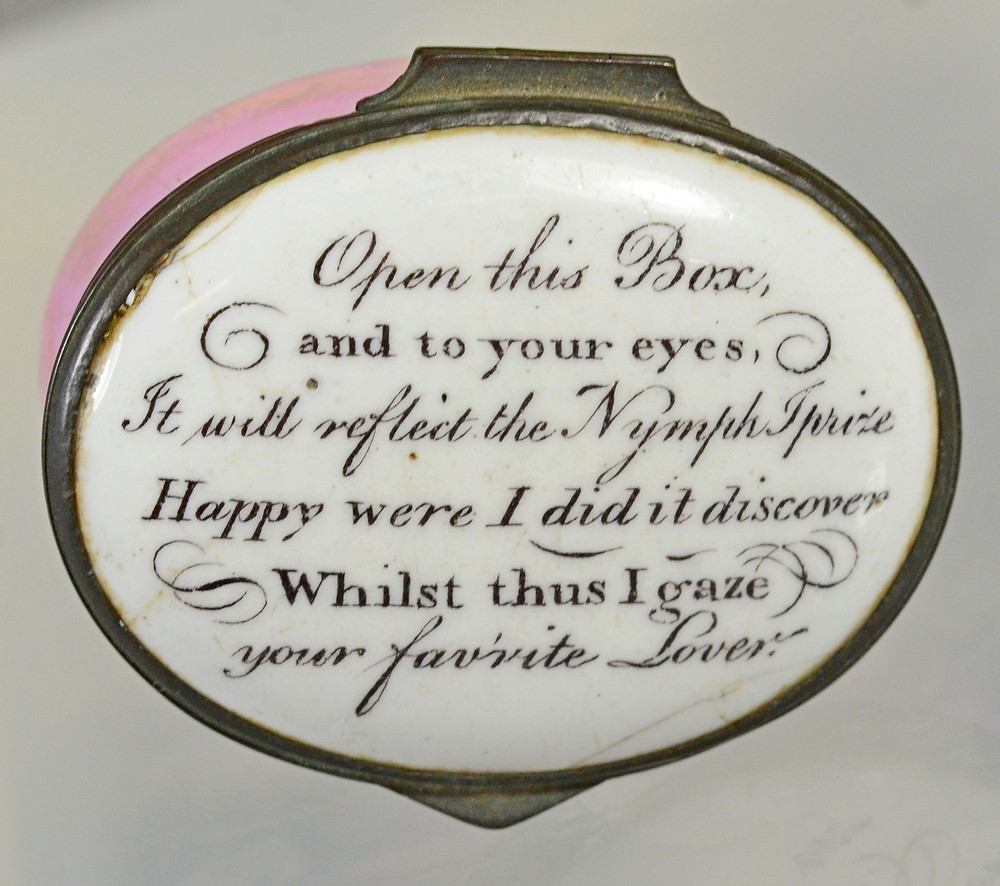 """Lot 12002 is a mirrored patch box inscribed with the message """"Open this box and to your eyes, It will reflect the Nymph prize, Happy were I did it discover, whilst I gaze, your favorite lover."""""""