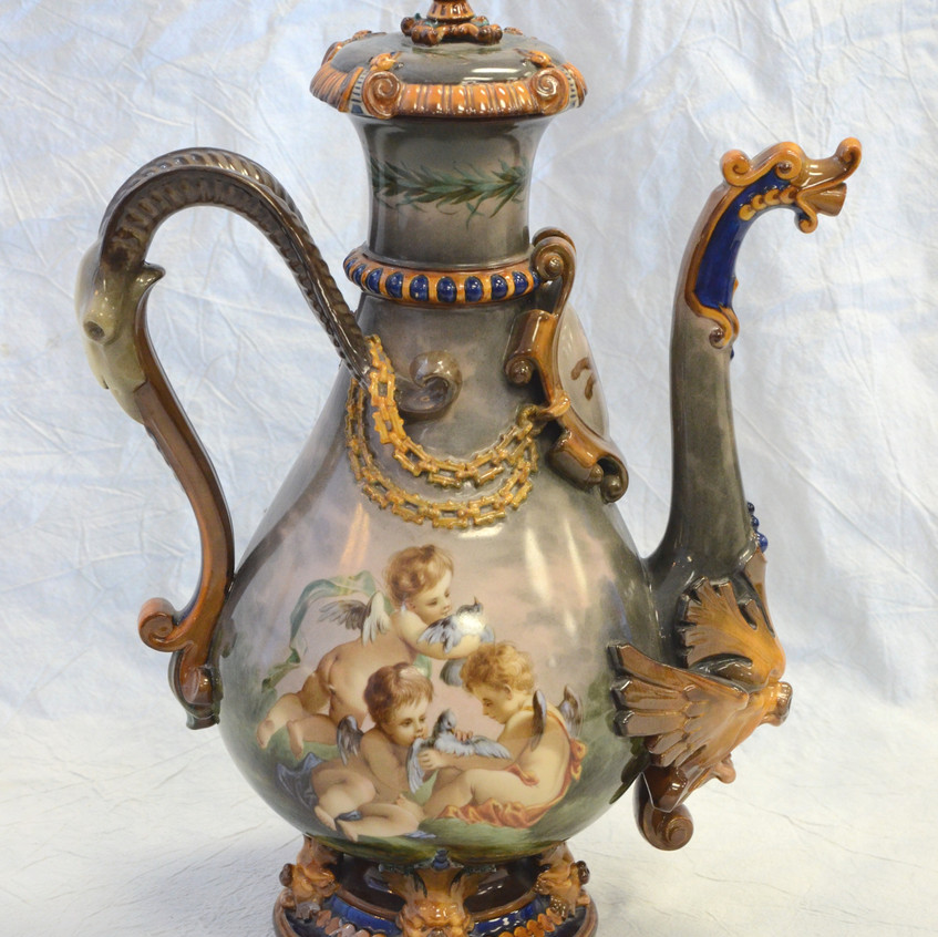 KPM porcelain lidded ewer, the body with hand painted cherub and bird decoration