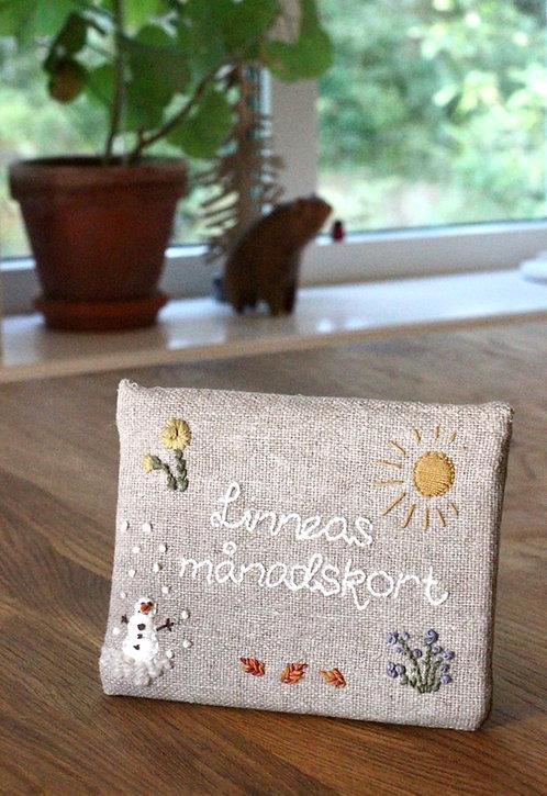 Linneas månadskort med broderat kuvert