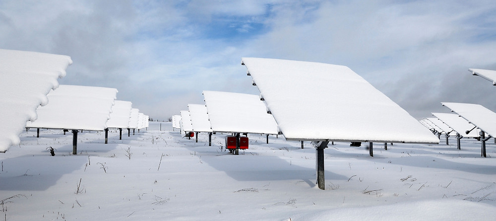 Solar Panels in Field Covered By Snow