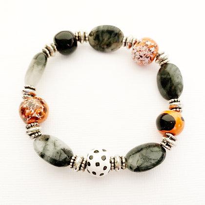 orange, black, white bracelet