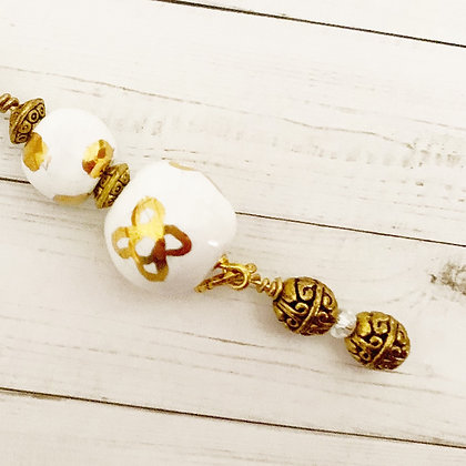 white with gold key chain