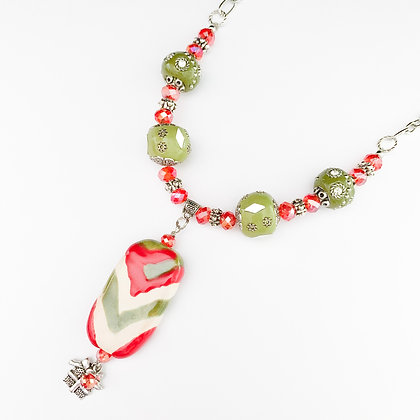 green and red ornate necklace