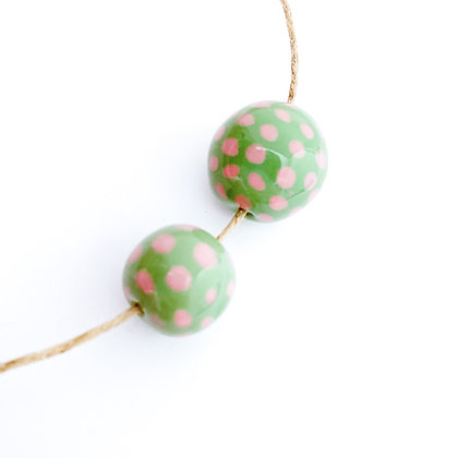 green with pink small dots round ball
