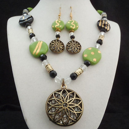 green and black necklace or earrings