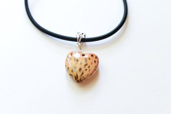 tan and brown cheetah pattern heart pendant