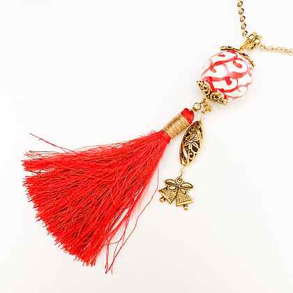 red, white and gold with tassel necklace