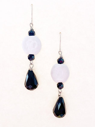 white coin with black teardrop earrings