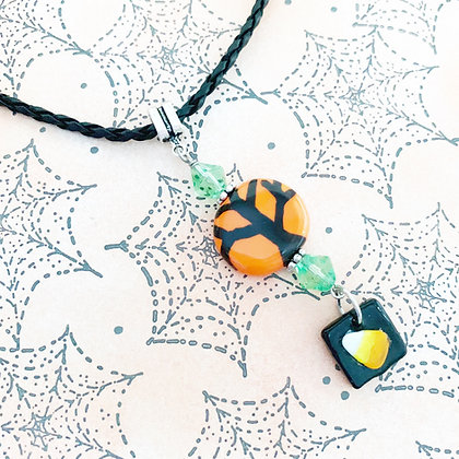 orange and black tree with candy corn charm pendant
