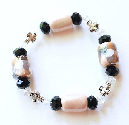 beige and black cross bracelet