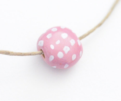petal pink with white dots coin
