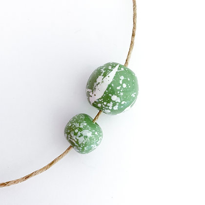 green with white speckle round ball