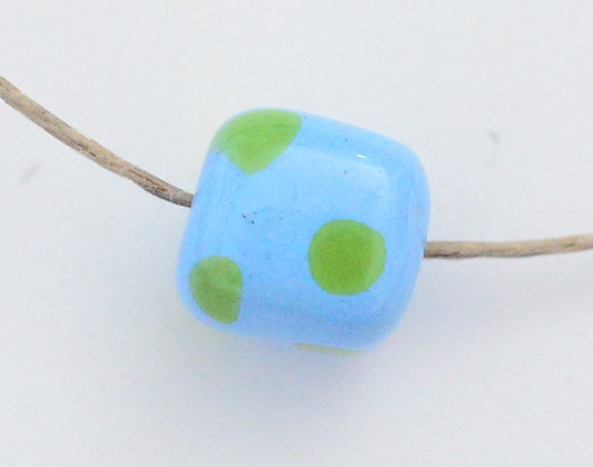 light blue with green dots cube