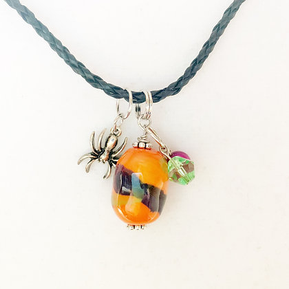orange splash with spider charm pendant