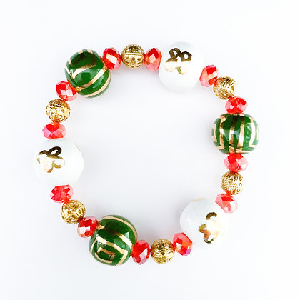 green and white with gold bracelet