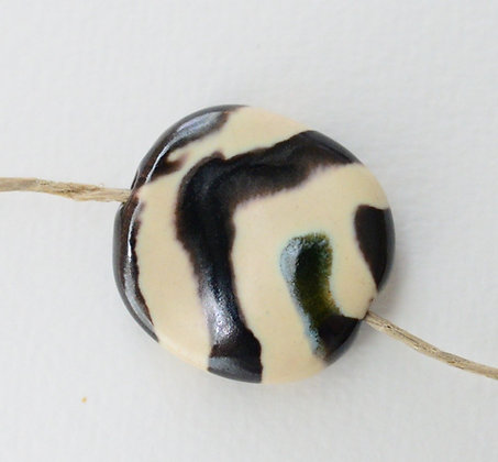 cream with brown gaby pita pat
