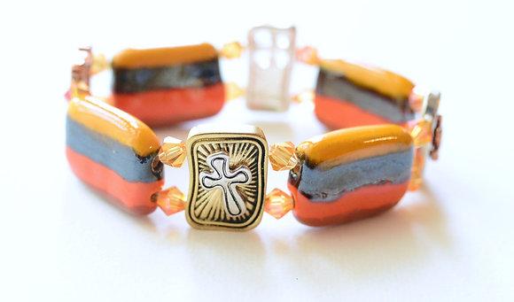 orange and yellow cross bracelet