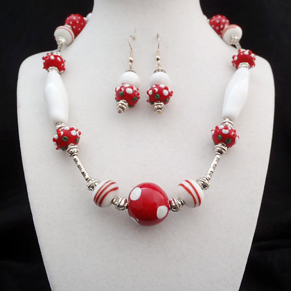 red and white necklace or earrings
