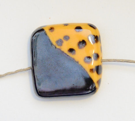 yellow and bronze square pendant