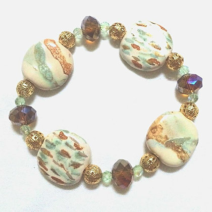 green, brown and gold bracelet