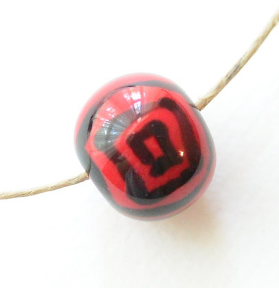 red with black squares round ball