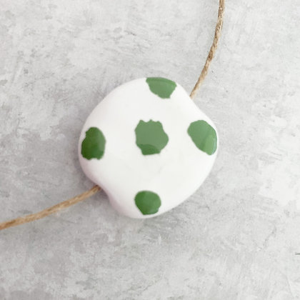 white with green large dots pita pat