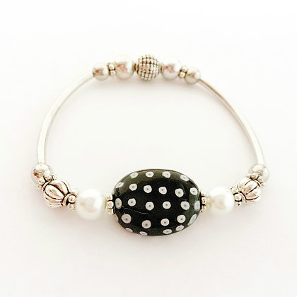 black with white dots silver tone bracelet
