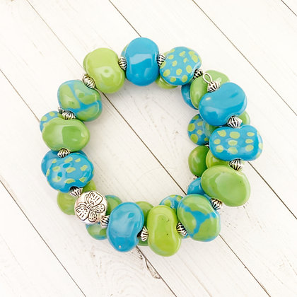 green and turquoise giraffe print wrap bracelet with buttlerfly