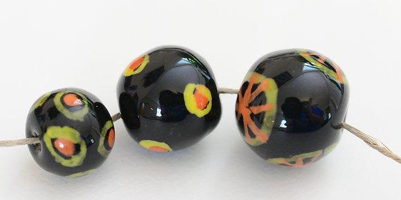 black with yellow & orange round ball