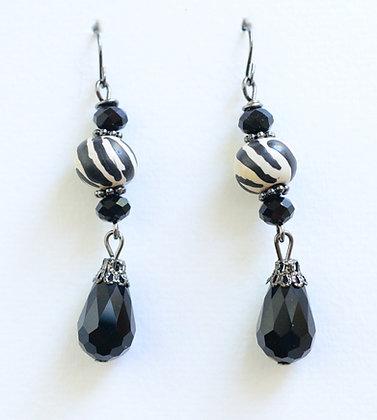 cream and black earrings