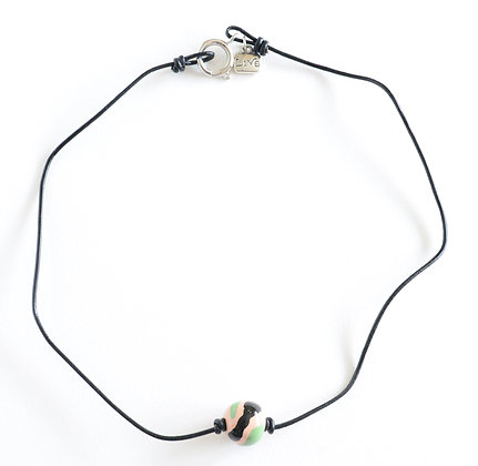 beige, black and green with black leather choker
